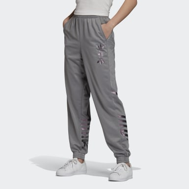 Large Logo Track Pants by Adidas, available on adidas.com for $70 Bella Hadid Pants SIMILAR PRODUCT