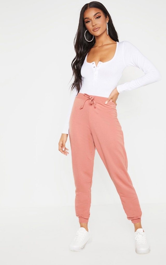 Dusty Rose Ultimate Marl Sweat Joggers by Pretty Little Thing, available on prettylittlething.com for $12 Camila Coelho Pants SIMILAR PRODUCT