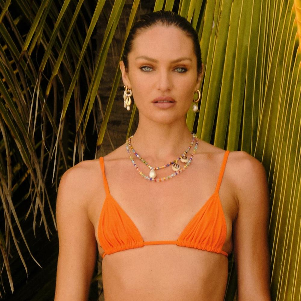 equator top in papaya by Tropic Of C, available on tropicofc.com for $80 Candice Swanepoel Top Exact Product