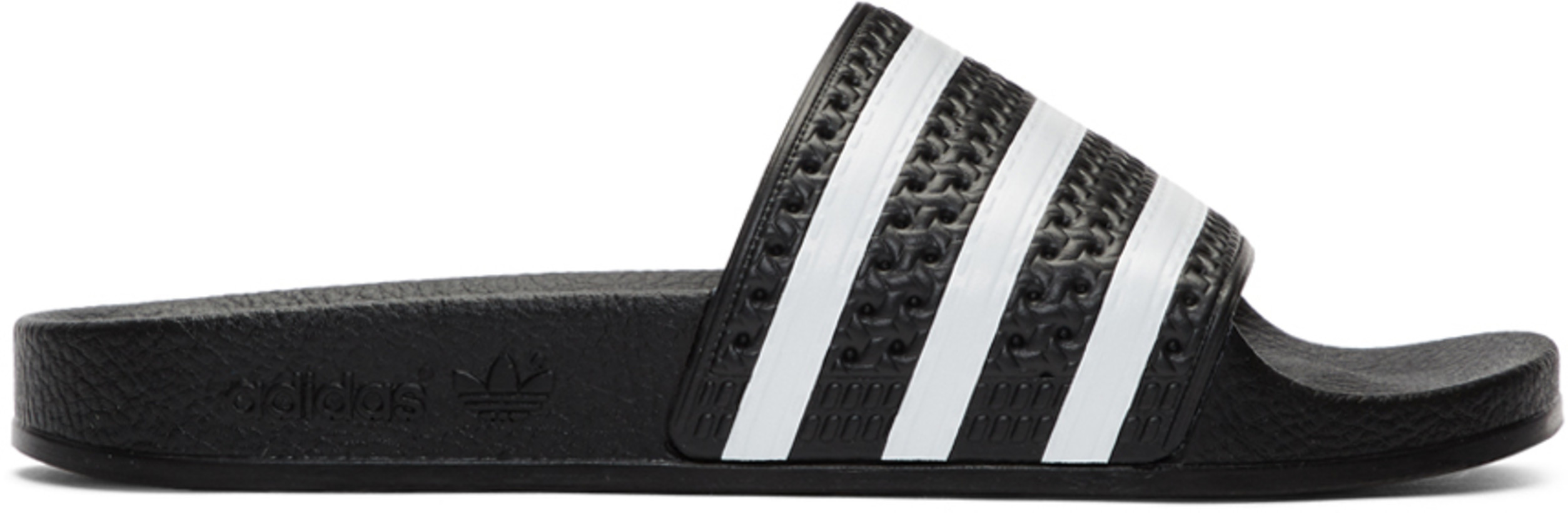 Black & White Adilette Slides by Adidas, available on ssense.com for $36 Chantel Jeffries Shoes Exact Product