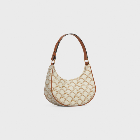 AVA BAG IN TRIOMPHE CANVAS AND CALFSKIN WHITE by Celine, available on celine.com for $1400 Elsa Hosk Bags Exact Product