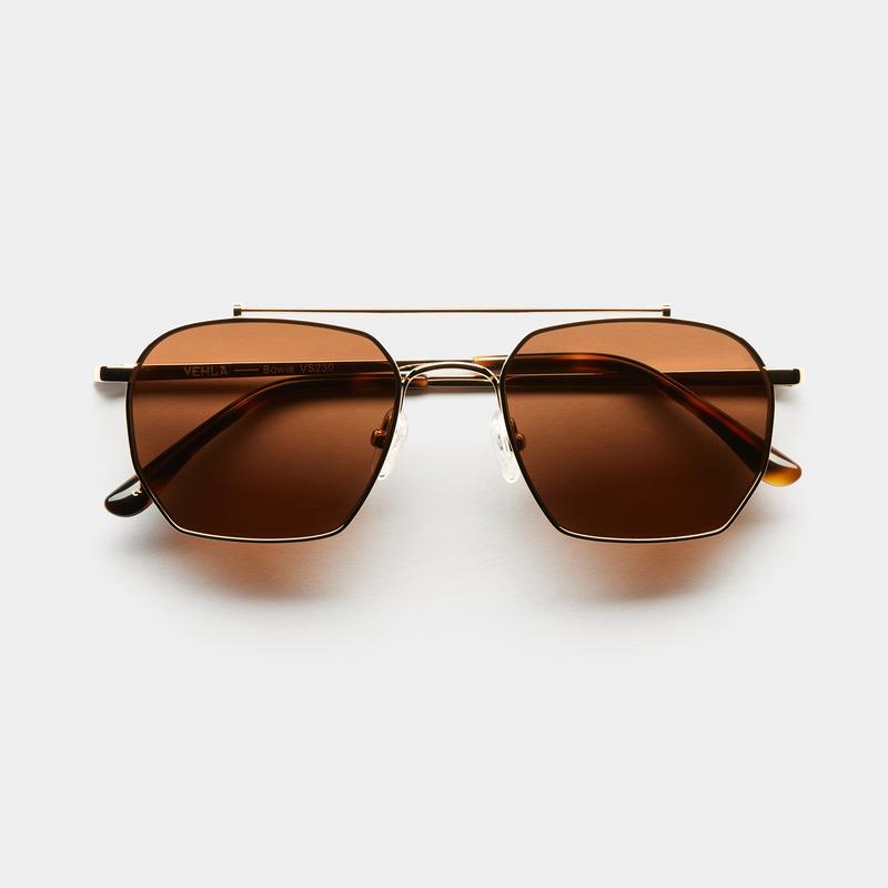 BOWIE - GOLD/CHOC by Vehla Eyewear, available on vehlaeyewear.com for $150 Gigi Hadid Sunglasses Exact Product