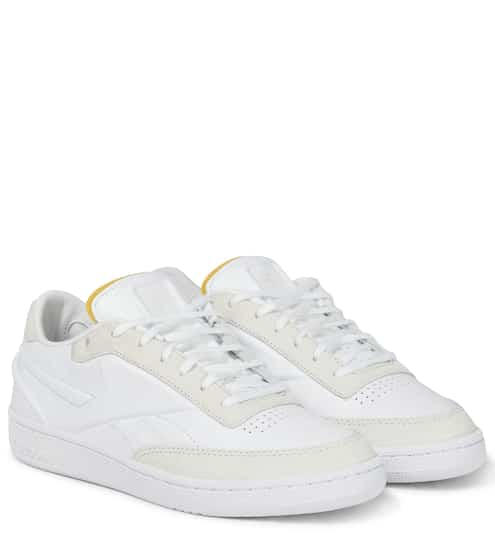 Club C leather sneakers by Reebok x Victoria Beckham, available on mytheresa.com for $196 Gigi Hadid Shoes Exact Product