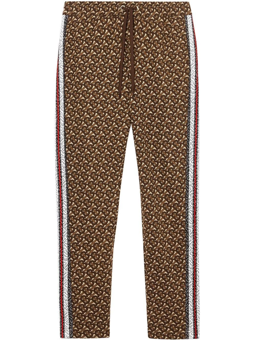 Monogram Stripe Print Cotton Trackpants by Burberry, available on farfetch.com for $760 Gigi Hadid Pants Exact Product