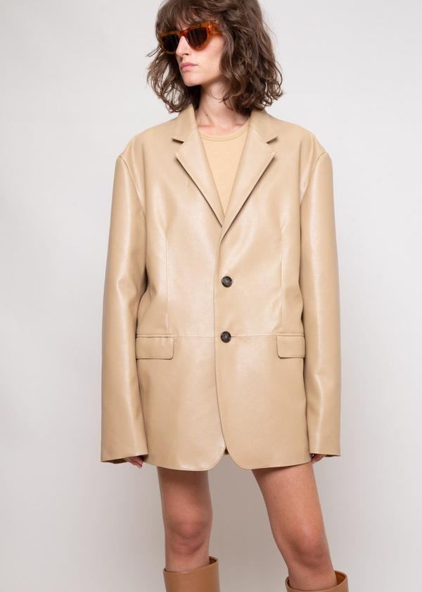 OVERSIZED FAUX LEATHER BLAZER IN BUTTER by The Frankie Shop, available on thefrankieshop.com for $195 Gigi Hadid Outerwear Exact Product