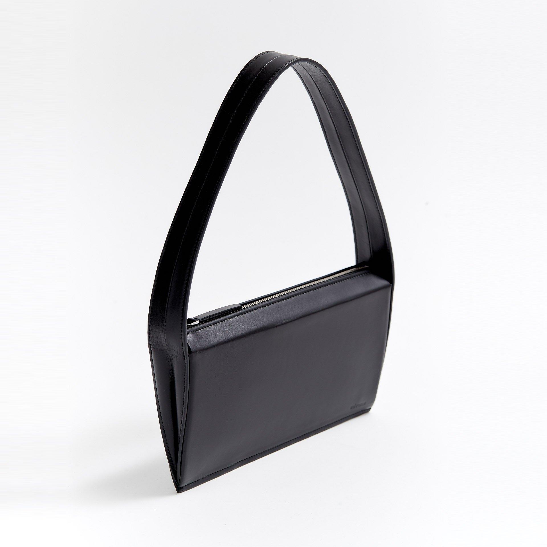 THE EDGE BAG | BLACK by Advene, available on advenedesign.com for $395 Irina Shayk Bags Exact Product