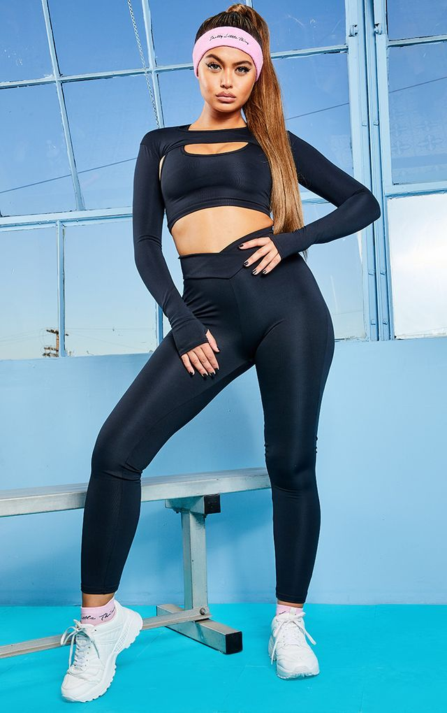 Black V Front Gym Leggings by Pretty Little Thing, available on prettylittlething.com for $14 Kaia Gerber Pants SIMILAR PRODUCT