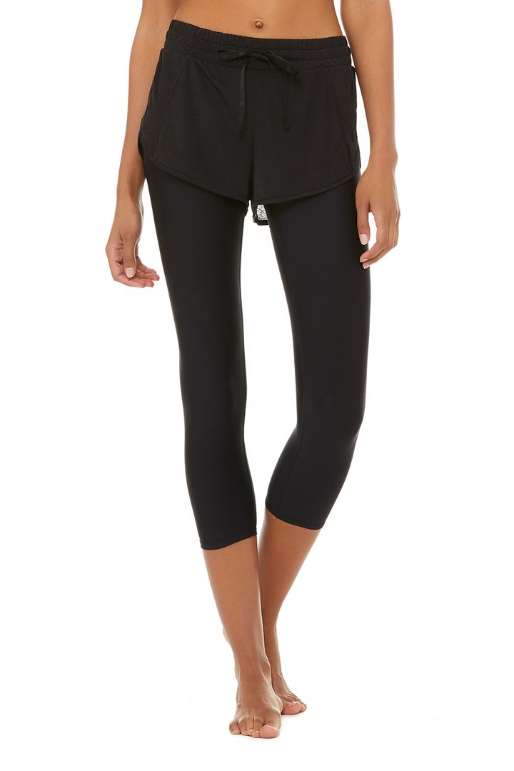 High-Waist 2-In-1 Capri by Alo Yoga, available on aloyoga.com for $118 Kaia Gerber Pants SIMILAR PRODUCT