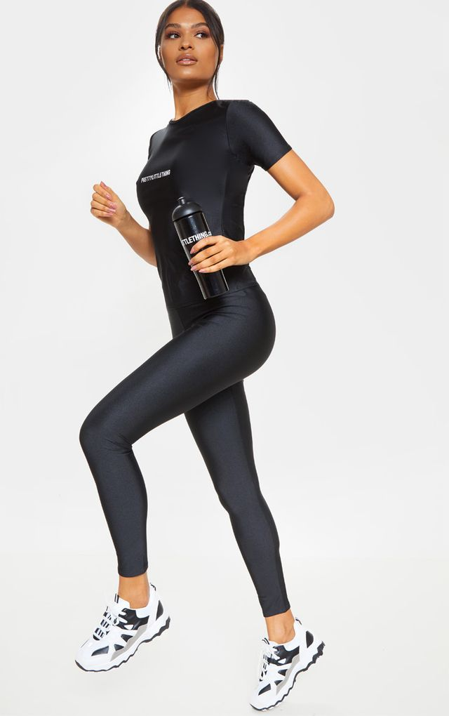 PRETTYLITTLETHING Black Basic Logo Gym Leggings by Pretty Little Thing, available on prettylittlething.com for $14 Kaia Gerber Pants SIMILAR PRODUCT