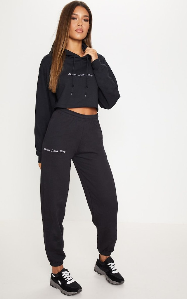 PRETTYLITTLETHING Black Embroidered Jogger by Pretty Little Thing, available on prettylittlething.com for $20 Kaia Gerber Pants SIMILAR PRODUCT