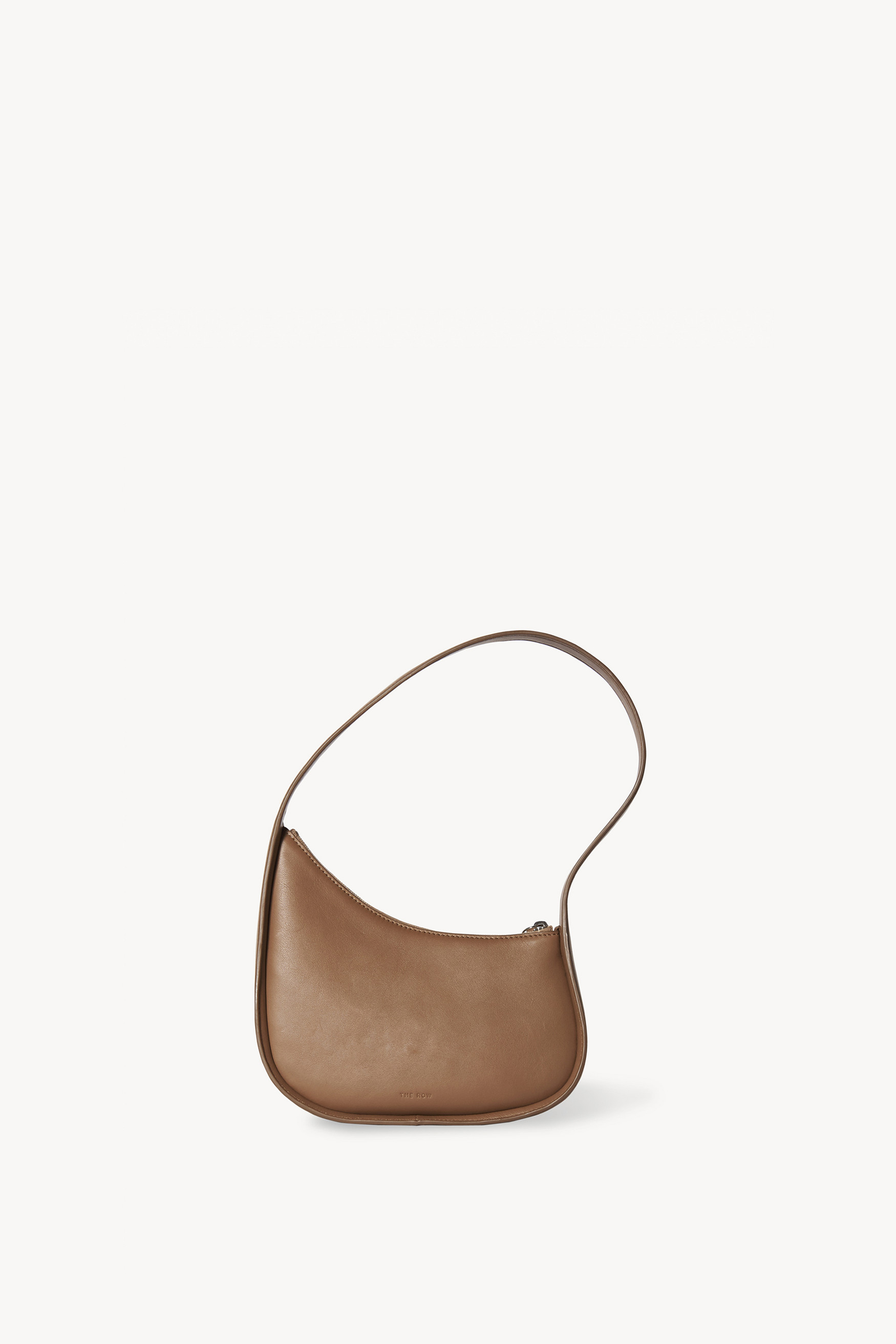 Half Moon Leather Shoulder Bag by The Row, available on saksfifthavenue.com for $1290 Kendall Jenner Bags Exact Product