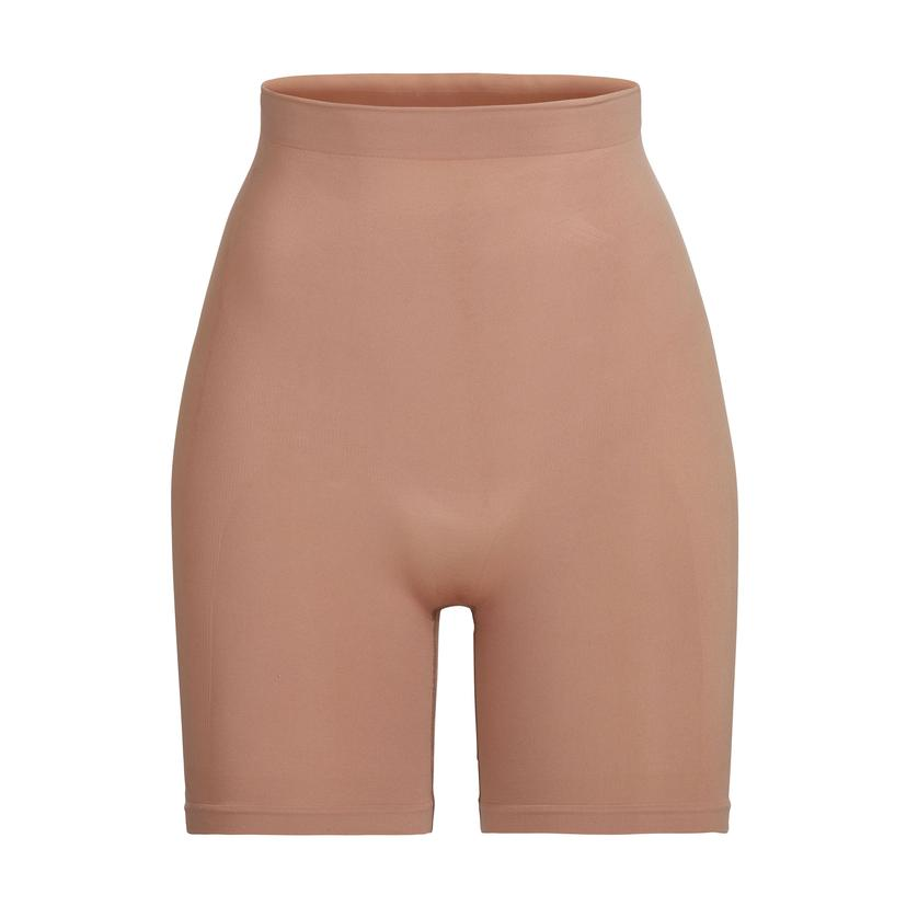 SCULPTING SHORT MID THIGH by Skims, available on skims.com for $36 Kendall Jenner Shorts SIMILAR PRODUCT