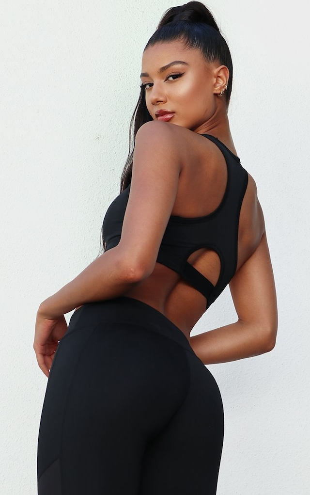 Black Contrast Basic Sports Bra by Pretty Little Thing, available on prettylittlething.com for $10 Khloe Kardashian Top SIMILAR PRODUCT