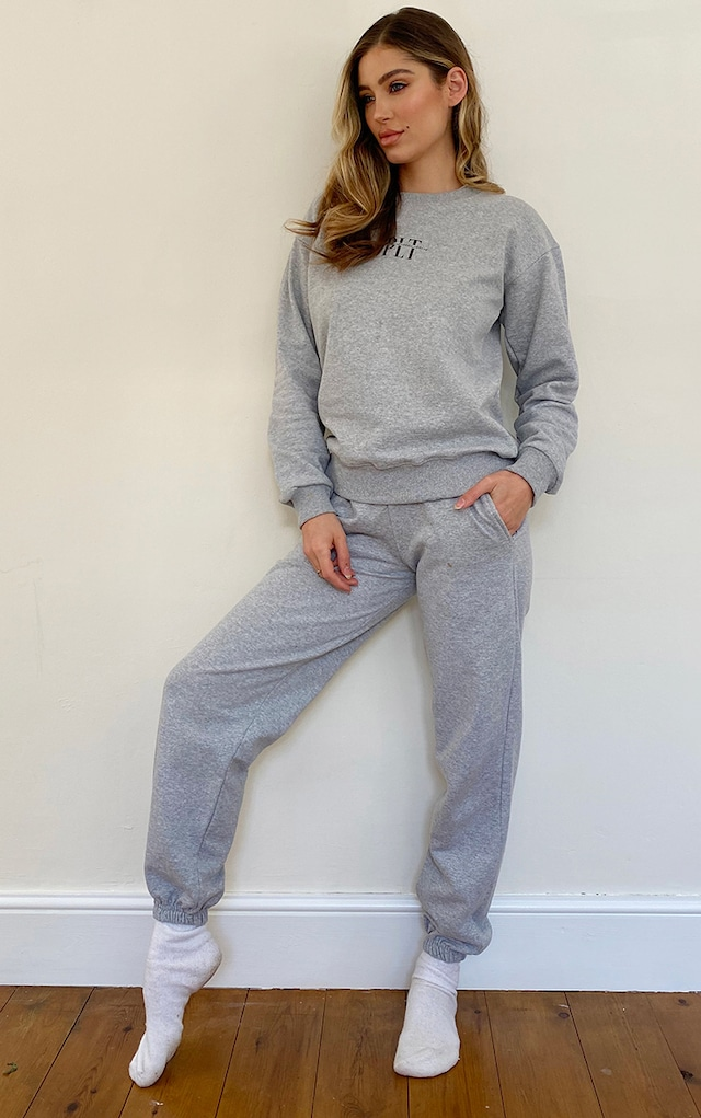 PRETTYLITTLETHING Grey Marl Slogan Print Joggers by Pretty Little Thing, available on prettylittlething.com for £20 Kim Kardashian Pants SIMILAR PRODUCT