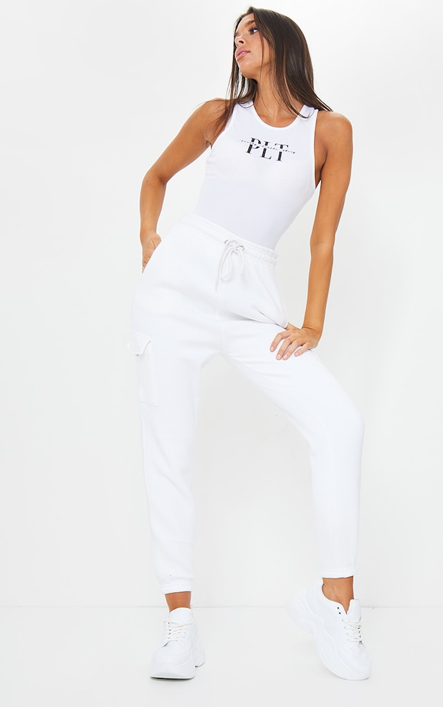 White Pocket Detail Casual Joggers by Pretty Little Thing, available on prettylittlething.com for £18 Kim Kardashian Pants SIMILAR PRODUCT