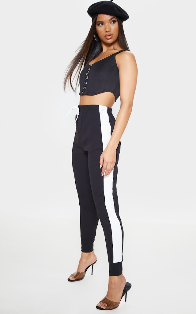 Black Side Stripe Detail Jogger by Pretty Little Thing, available on prettylittlething.com for $11 Kourtney Kardashian Pants SIMILAR PRODUCT