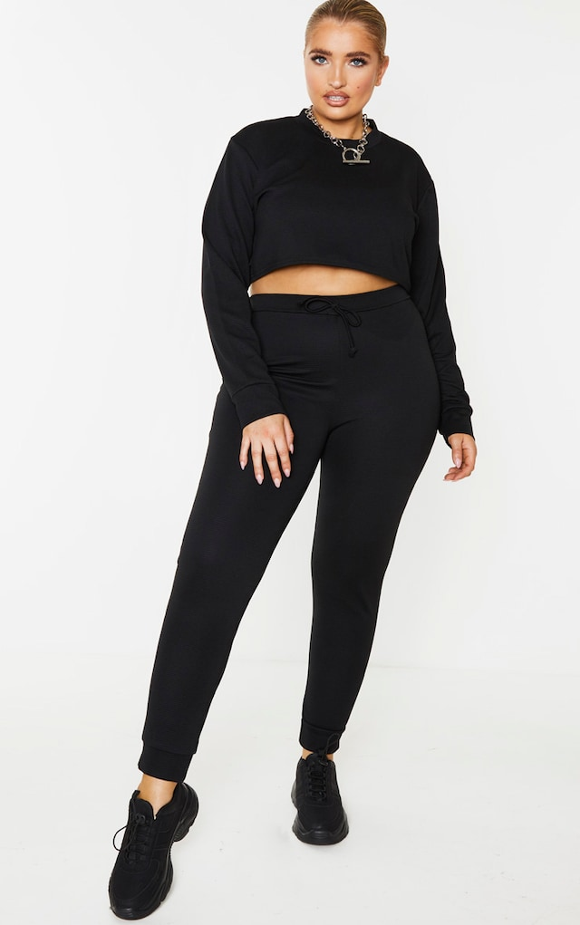 Plus Black Wide Rib Tie Waist Joggers by Pretty Little Thing, available on prettylittlething.com for $13 Kourtney Kardashian Pants SIMILAR PRODUCT