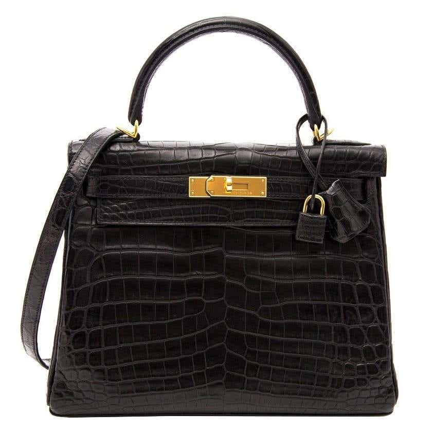 Black Kelly 28 matte Croco Niloticus 28 by HERMES, available on 1stdibs.com for $72 Kylie Jenner Bags Exact Product