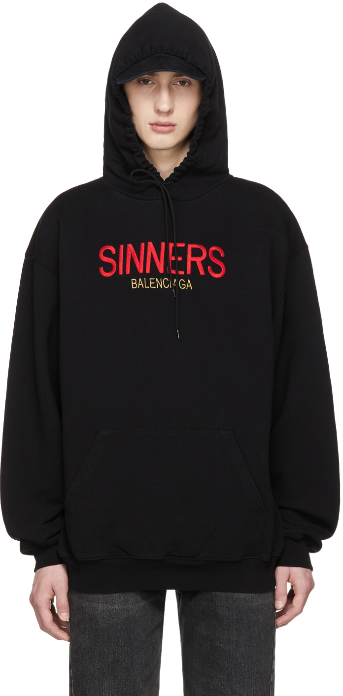 Black Oversized 'Sinners' Hoodie by Balenciaga, available on ssense.com for $995 Kylie Jenner Top Exact Product