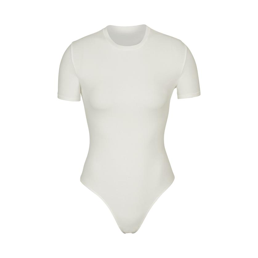 COTTON JERSEY T-SHIRT BODYSUIT by Skims, available on skims.com for $66 Kylie Jenner Top SIMILAR PRODUCT