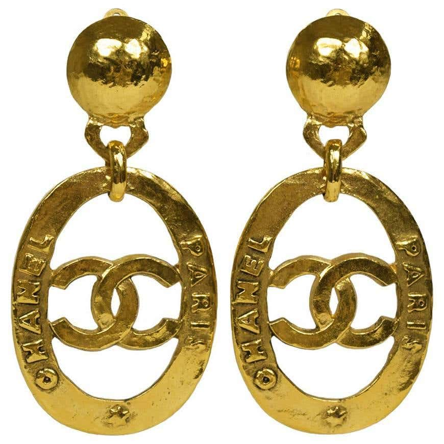 Chanel Vintage Gold Large CC Chanel Paris Doorknocker Round Hoop Earrings in Box by Chanel, available on 1stdibs.com Kylie Jenner Jewellery Exact Product