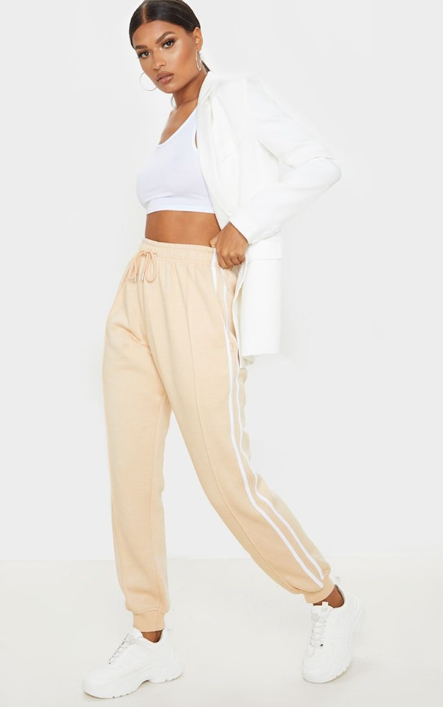 Fawn Double Side Stripe Jogger by Pretty Little Thing, available on prettylittlething.com for £10 Kylie Jenner Pants SIMILAR PRODUCT