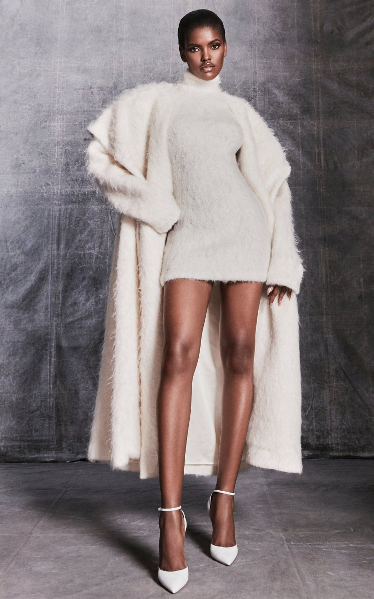 Hooded Textured-Knit Coat by Laquan Smith, available on modaoperandi.com for $3000 Kylie Jenner Outerwear Exact Product
