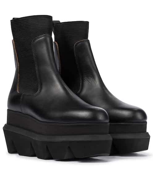 Platform leather Chelsea boots by Sacai, available on mytheresa.com for $917 Kylie Jenner Shoes SIMILAR PRODUCT