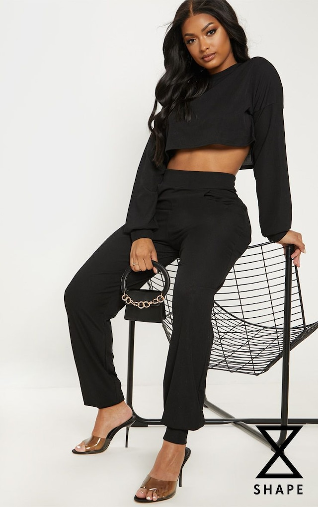 Shape Black Ribbed Cuff Detail Joggers by Pretty Little Thing, available on prettylittlething.com for £13 Kylie Jenner Pants SIMILAR PRODUCT