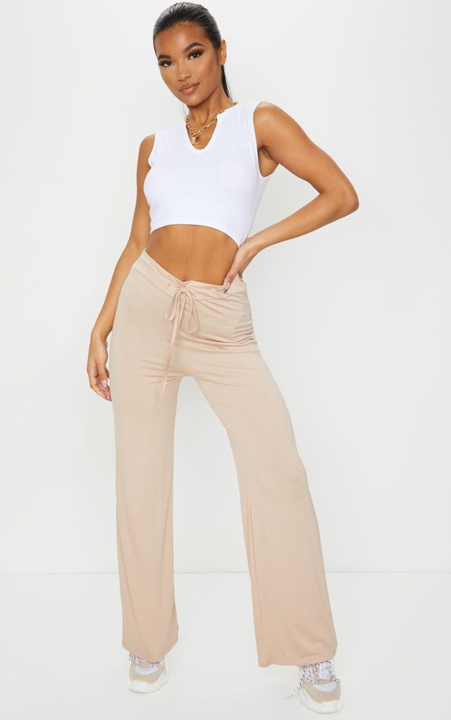 Stone Drawstring Jersey Wide Leg Jogger by Pretty Little Thing, available on prettylittlething.com for $15 Kylie Jenner Pants SIMILAR PRODUCT