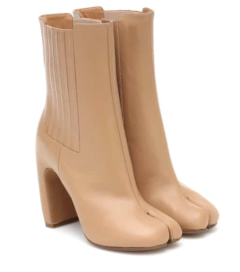 Tabi leather ankle boots by Maison Margiela, available on mytheresa.com for $615 Kylie Jenner Top SIMILAR PRODUCT