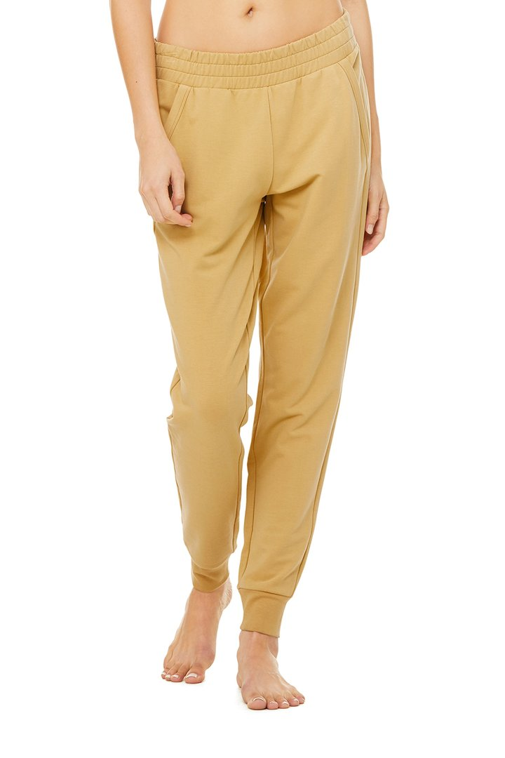 Unwind Sweatpant - Honey by Alo Yoga, available on aloyoga.com for $98 Kylie Jenner Pants SIMILAR PRODUCT