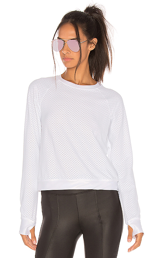 Sofia Pullover by KORAL, available on revolve.com for $98 Natasha Oakley Top SIMILAR PRODUCT