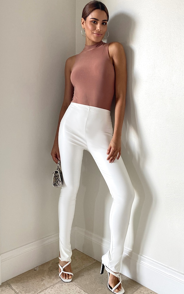 Tall White Faux Leather Split Hem Leggings by Pretty Little Thing, available on prettylittlething.com for $18 Natasha Oakley Pants SIMILAR PRODUCT