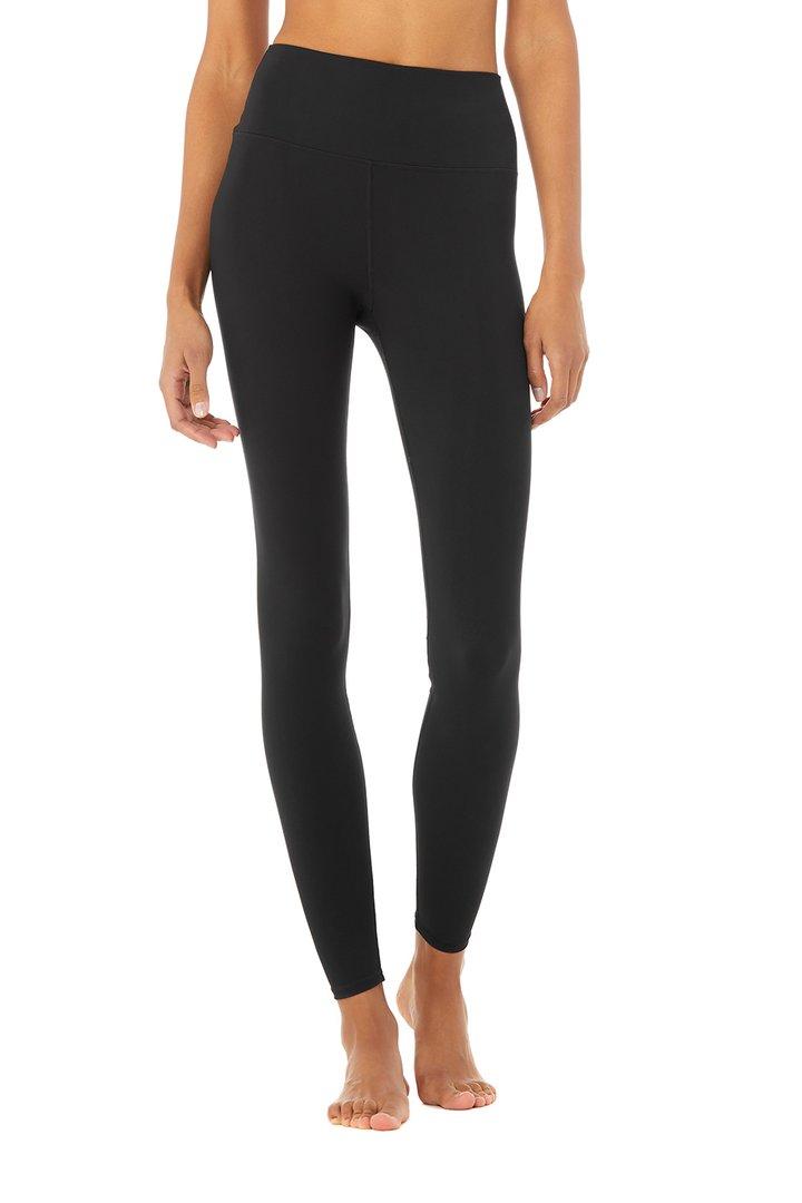 High-Waist Solid Vapor Legging by Alo Yoga, available on aloyoga.com for $128 Rita Ora Pants SIMILAR PRODUCT