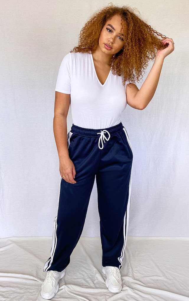Plus Navy Side Stripe Zip Hem Drawstring Joggers by Pretty Little Thing, available on prettylittlething.com for $18 Selena Gomez Pants SIMILAR PRODUCT