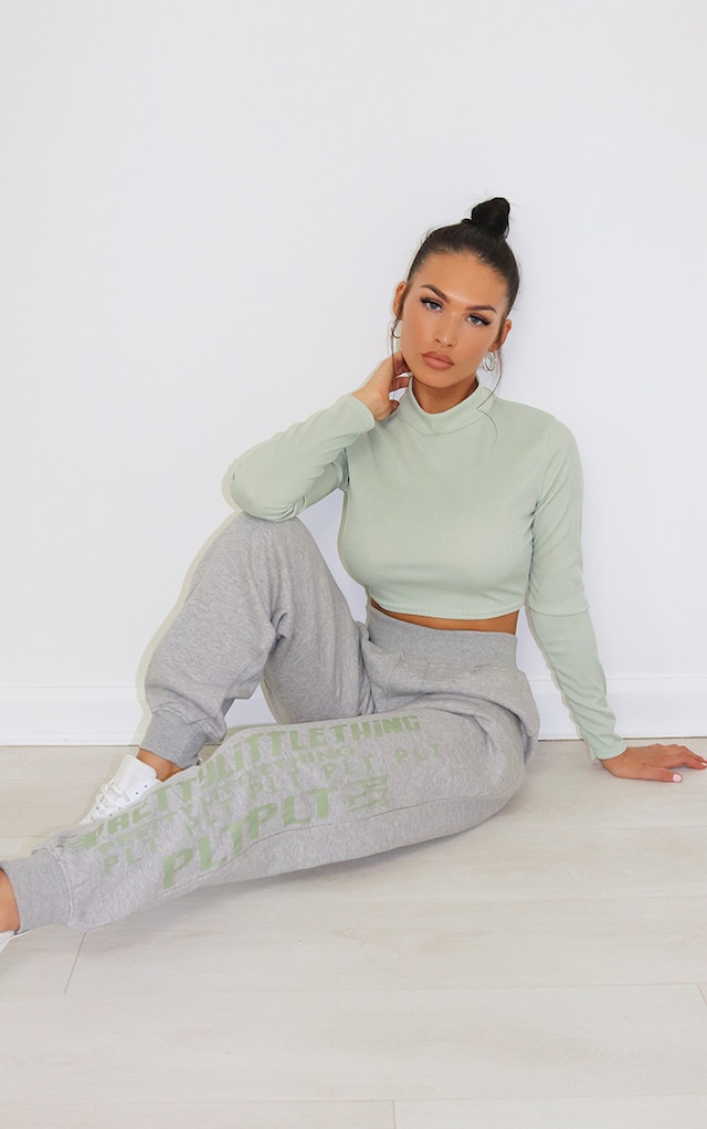 PRETTYLITTLETHING Grey Multi Logo Joggers by Pretty Little Thing, available on prettylittlething.com for $20 Winnie Harlow Pants SIMILAR PRODUCT