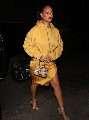 Rihanna donning silver open toe sandals with high heel and broad ankle strap