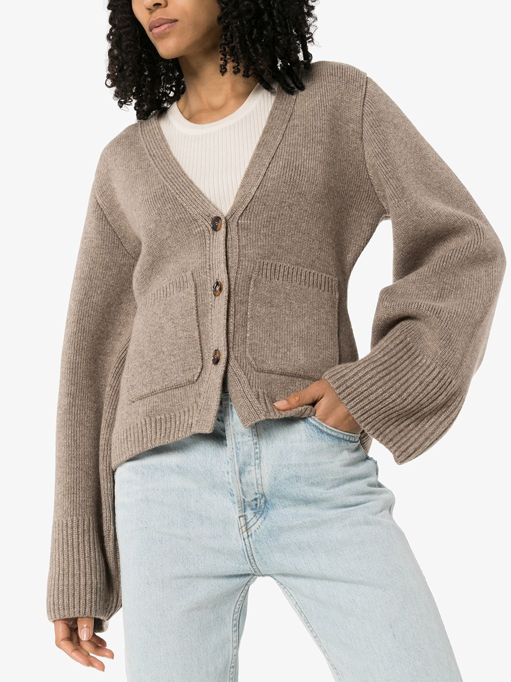 Rihanna donning a Casual taupe ribbed Khaite woolen cardigan with a woolen fabric, extra long sleeves, button front and a V-neck