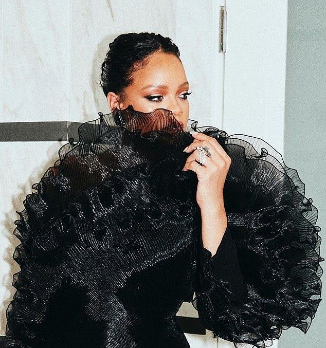 Rihanna rocking black crisscross tie sandals with high heel