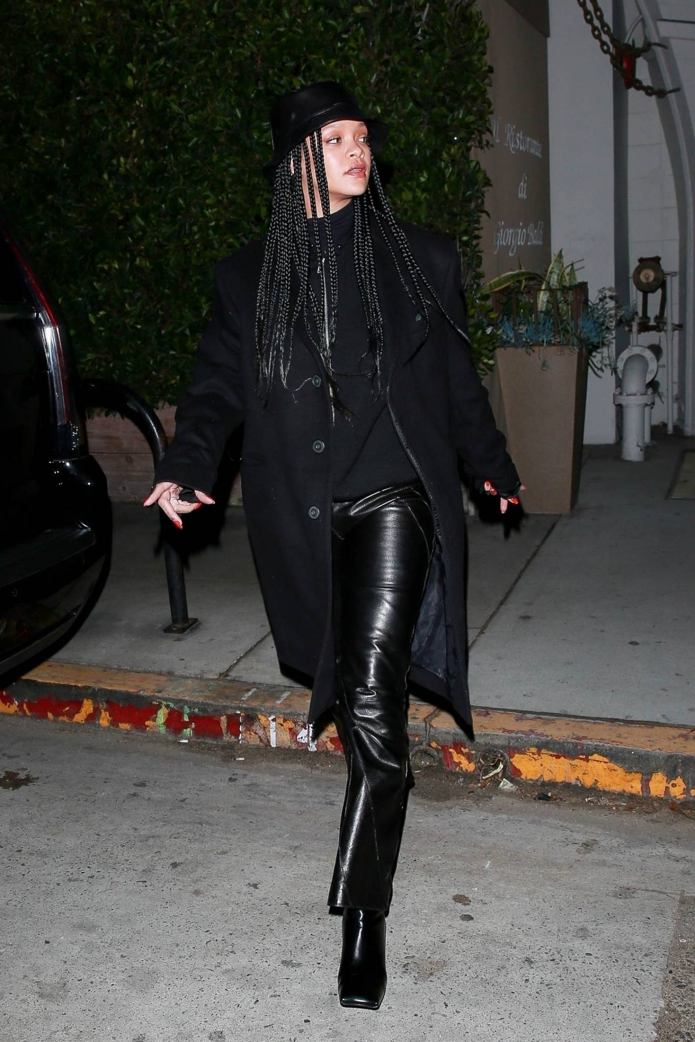 Rihanna rocking square black leather boots with high heel