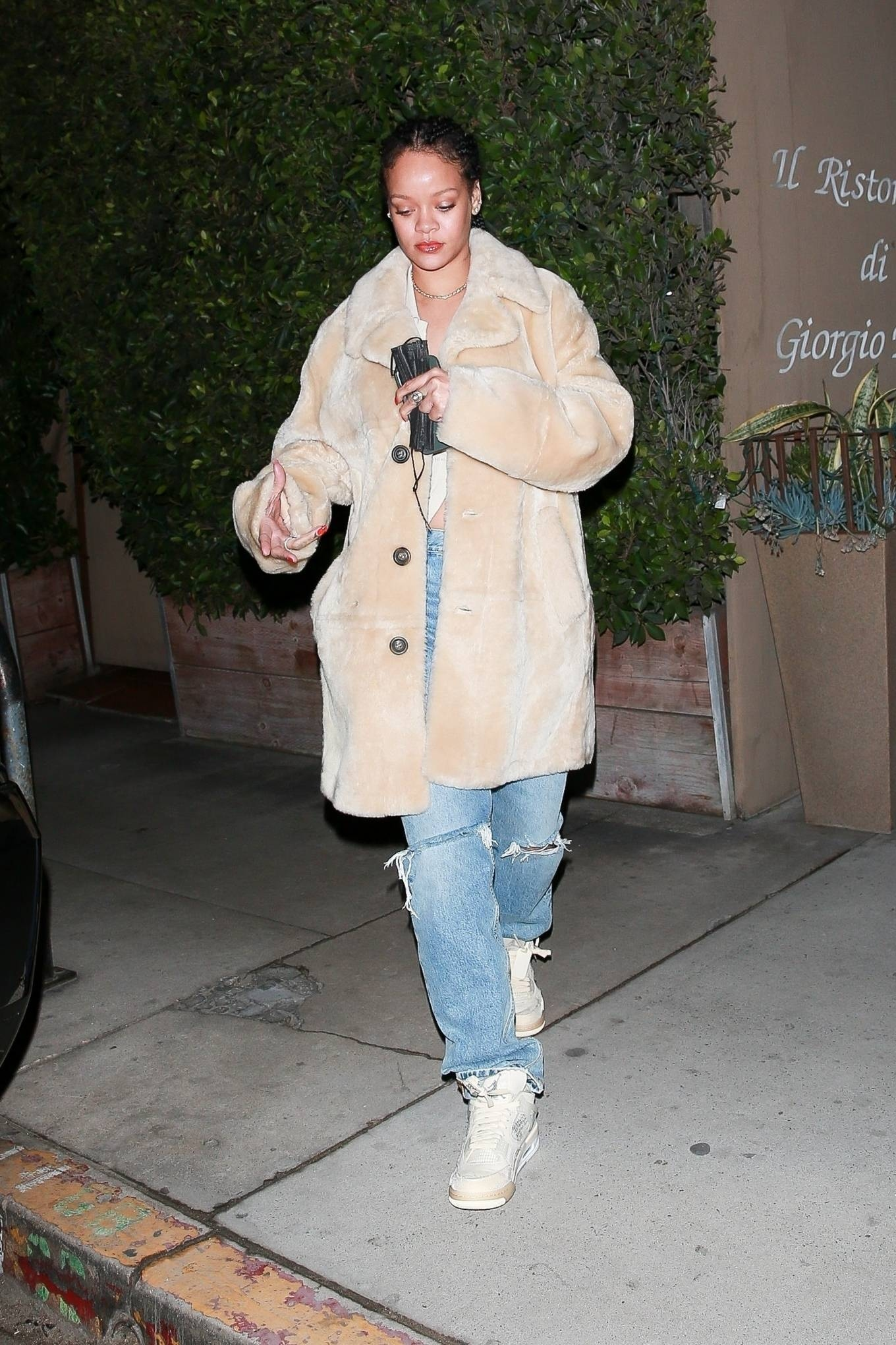 Rihanna rocking white mesh lace-up high top sneakers