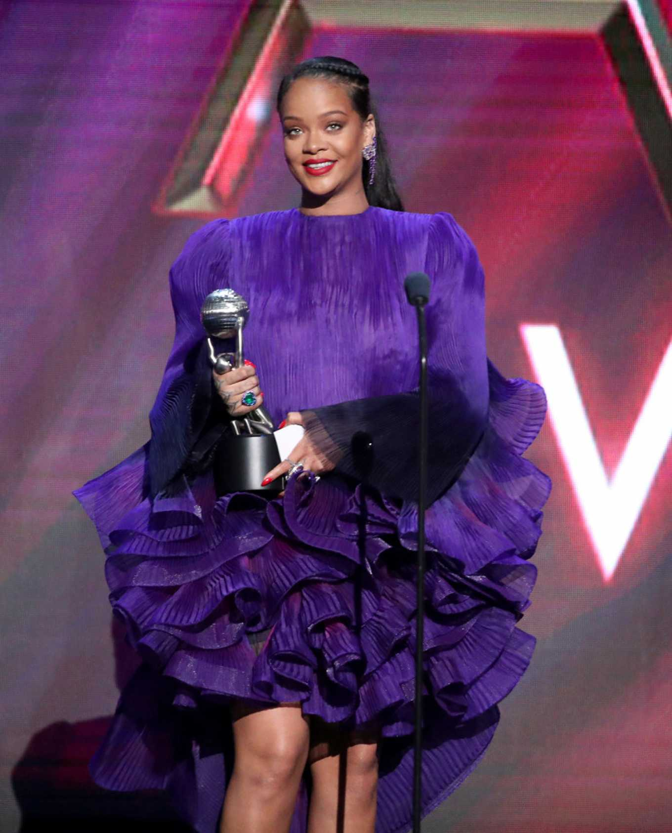 Rihanna donning strappy purple ankle sandals with high heel and thin straps
