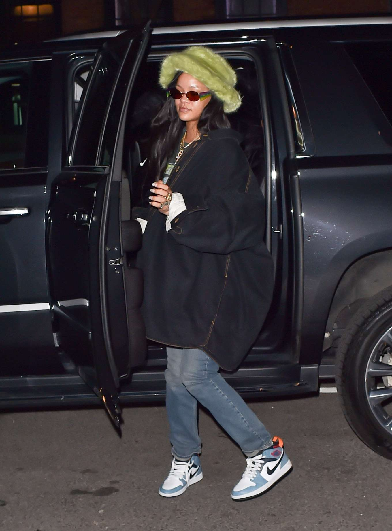 Rihanna rocking brand logo blue white lace-up sneakers