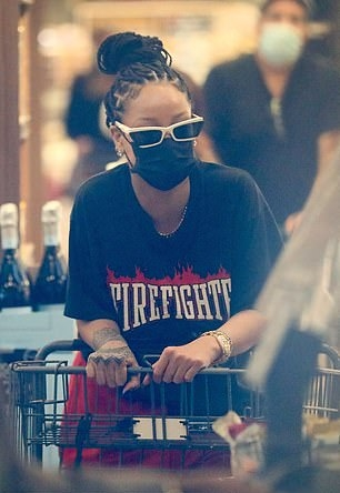 Rihanna wearing white ankle sneakers