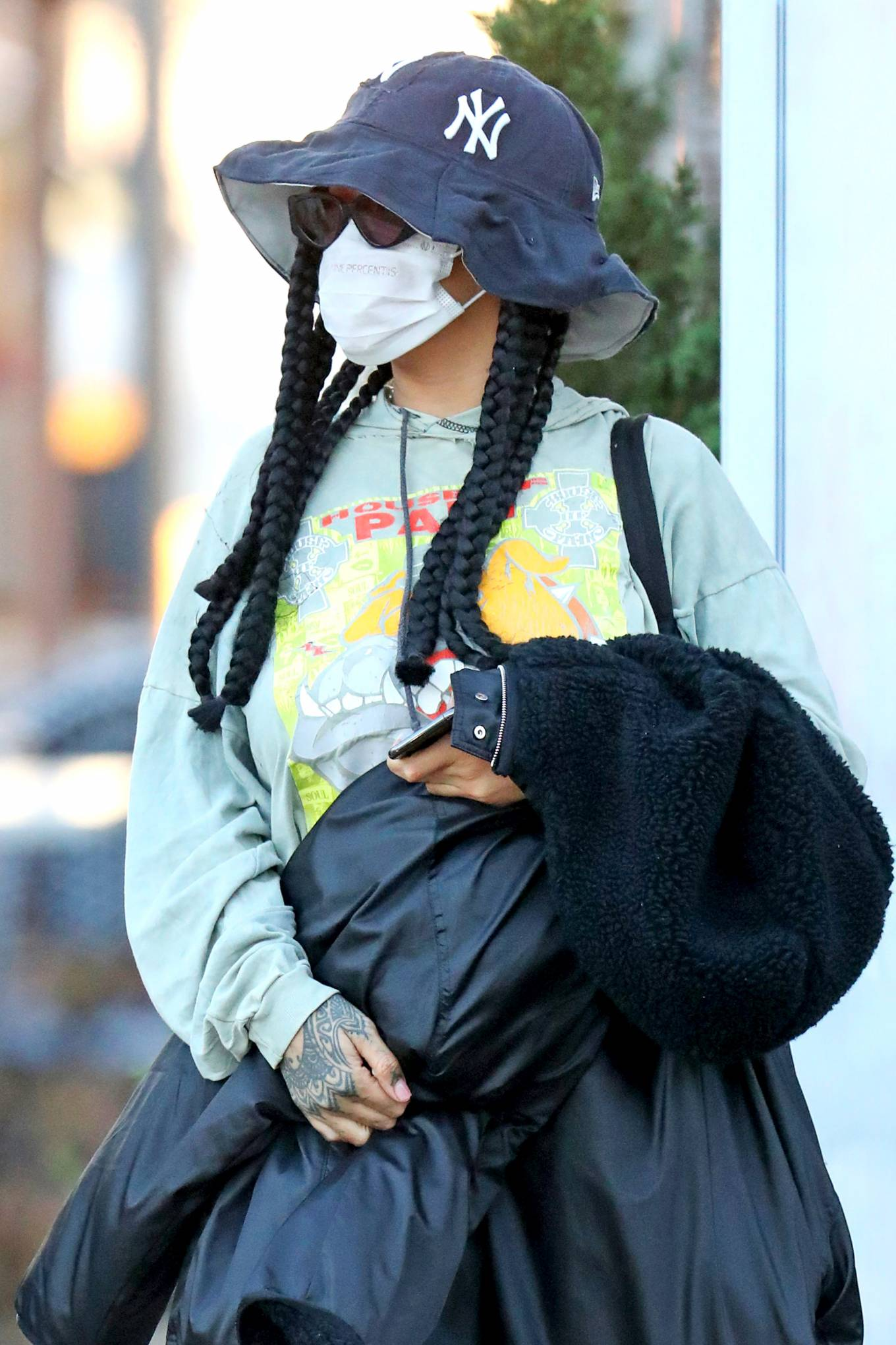Rihanna wearing white ankle high top sneakers