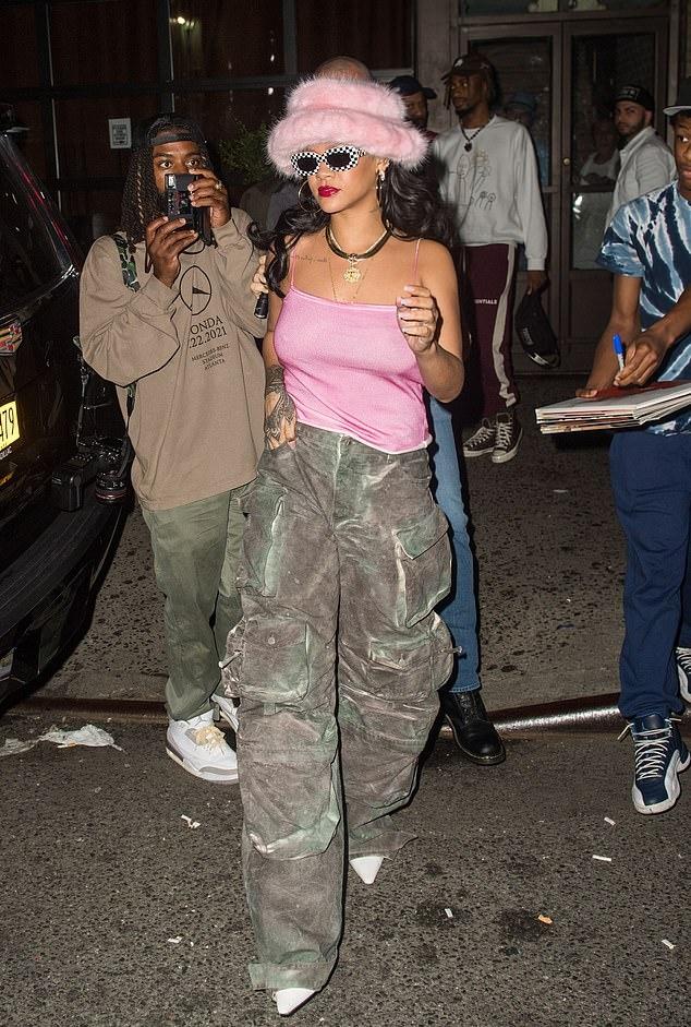 Rihanna rocking pointed white slip on pumps