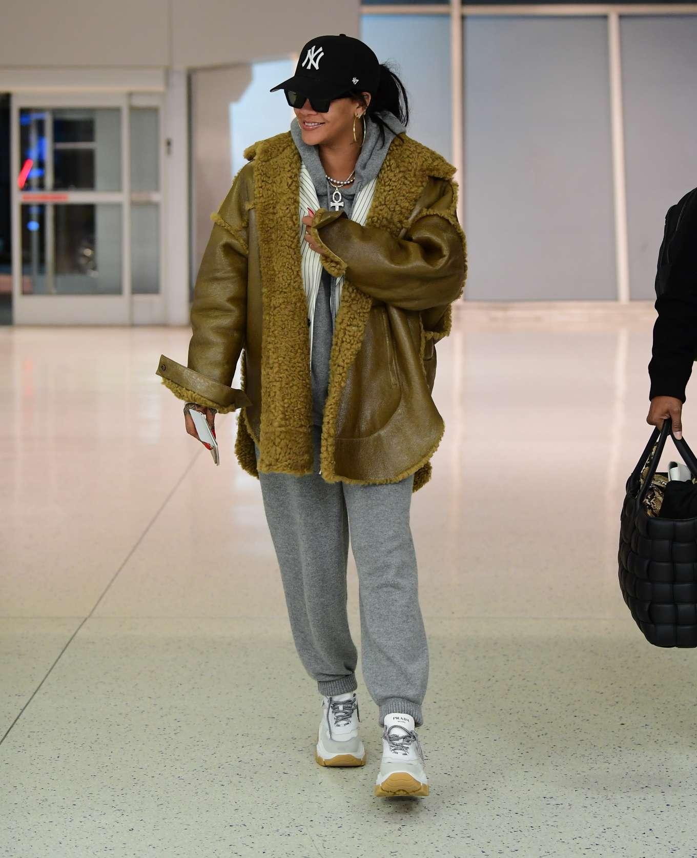 Rihanna rocking white mustard lace-up trainers