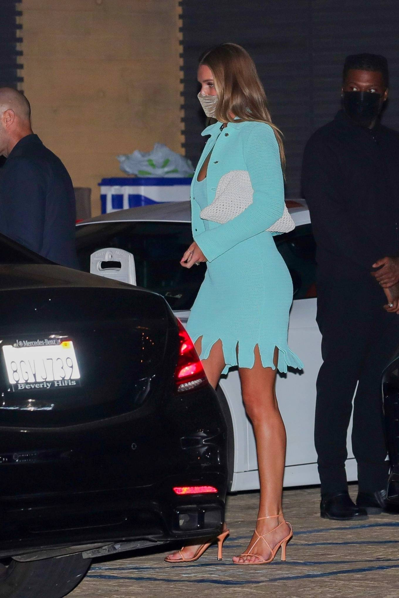 Rosie Huntington Whiteley wearing a fitted Bottega Veneta dress with a cotton material