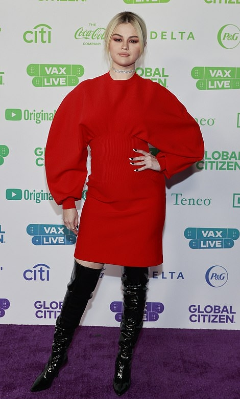 Selena Gomez wearing a baggy red dress by Bottega Veneta while at the Vax Live concert in California
